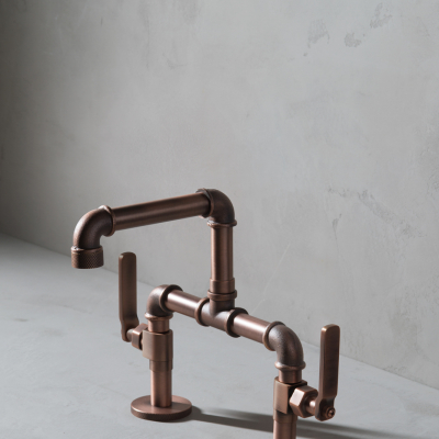 A Copper Deck Mounted Basin Tap with Lever Handles