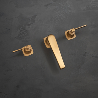 A Brass Deck Mounted Basin Tap with Lever Handles