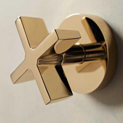 A Brass Wall Mounted Shower Mixer with Cross Handles