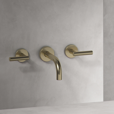 A Brass Wall Mounted Basin Tap with Lever Handles