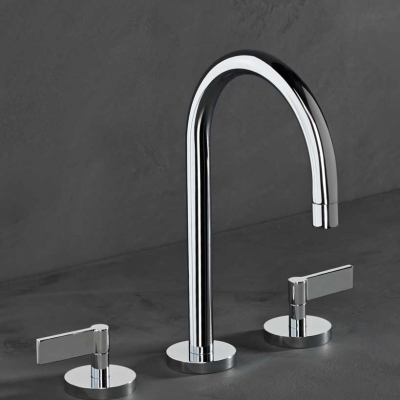 A Silver Deck Mounted Basin Tap with Lever Handles