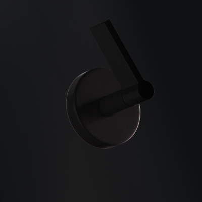 A Black Wall Mounted Basin Item with Lever Handles